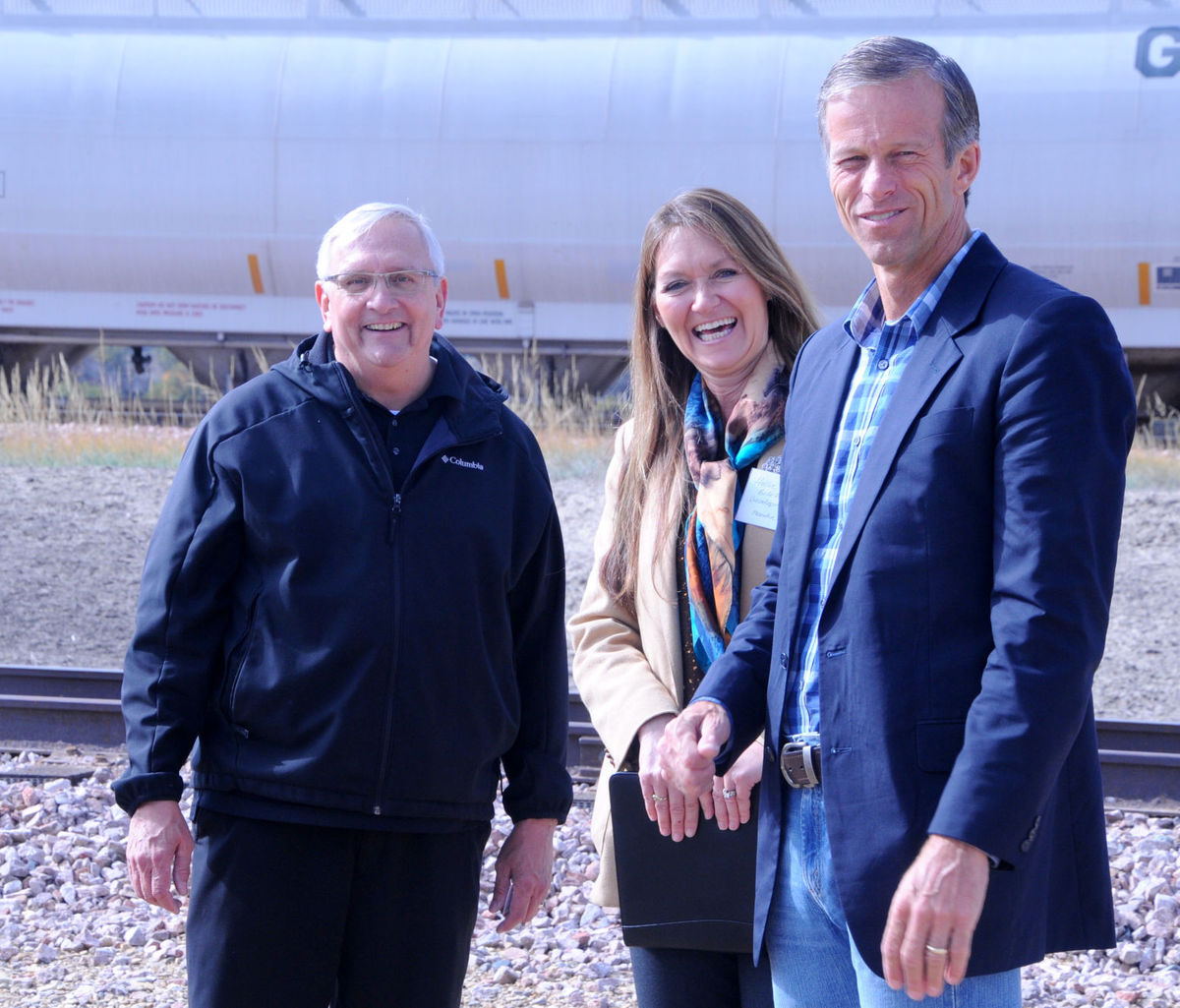 Photo credit: Milo Dailey, Butte County Post. Chamber Director Gary Wood and Belle Fourche EDC Executive Director Hollie Stalder stand with Senator John Thune at the Industrial Rail Park ribbon cutting.